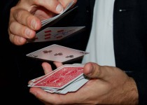 Website - Commercial - Magician shuffling cards